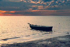 Anchored fishing boat on a beach of the Baltic Sea, Latvia Stock Images