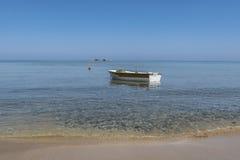 Anchored fishing boat Stock Photo