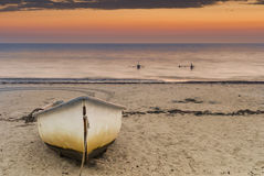 Anchored fishing boat at dawn Stock Photos