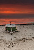 Anchored fishing boat at dawn Stock Images