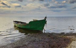 Anchored fishing boat at sandy beach of the Baltic Sea Stock Image