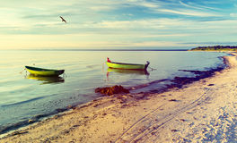 Anchored fishing boats at sandy beach of the Baltic Sea Stock Photography