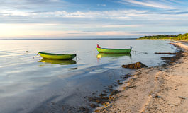 Anchored fishing boats at sandy beach of the Baltic Sea Stock Photos