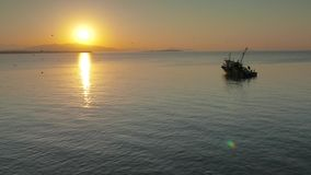 Anchored fishing trawler in the morning with stock video