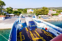 Lorry trucks are entering ferryboat, boarding cars stock photos