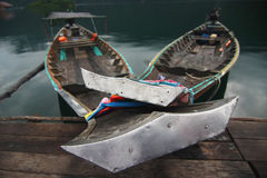 Anchored long-tailed boats in the lake Royalty Free Stock Image