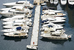 Anchored luxury yachts. Luxury yachts to drop anchor in seaport Royalty Free Stock Photo