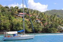 Anchored in Marigot Bay. This picturesque shot shows a nice sail boat in a tropical setting near Marigot Bay in St. Lucia Royalty Free Stock Image