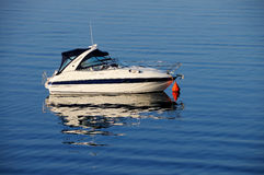Anchored motor boat. Yacht boat anchored, pictured on warm morning sunlight Stock Images