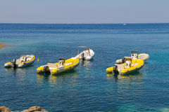 Anchored motorboats in waters of Tyrrhenian Sea, Sant Andreas Royalty Free Stock Images