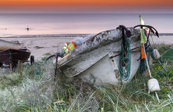 Anchored old fishing boat Stock Images