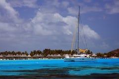 Anchored in paradise. Catamaran anchored in the lagoon of Bora Bora ( French Polynesia - Society Islands Royalty Free Stock Photos