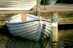 Anchored Row Boat. A small anchored rowing boat Stock Photography