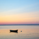 Anchored rowboat at sunset Stock Photography