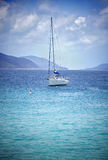 Anchored sailboat. Luxury sailboat anchored in the waters of the British Virgin Islands Royalty Free Stock Photo