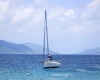 Anchored sailboat. Luxury sailboat anchored in the waters of the British Virgin Islands Royalty Free Stock Photography