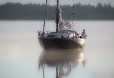 An anchored sailboat Royalty Free Stock Photos