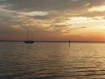 Anchored sailboat. Sunrise on Captiva Island Florida, over Pine Island Sound Royalty Free Stock Photos