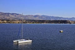 Anchored Sailboats. Two anchored sailboats in the middle of a lake on a summer's day in Montana Stock Image