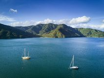 Arial view of Momorangi Bay and sailboats in New Zealand royalty free stock photos