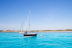 Anchored sailboats in turquoise Formentera beach Stock Photography
