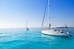Anchored sailboats in turquoise Formentera beach Royalty Free Stock Image