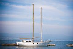 Anchored Sailing. Sailboat moored at a dock in Galicia, Spain Stock Image