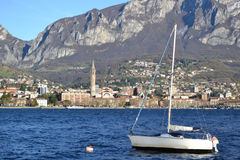 Anchored sailing boat at lake Como and view to Lecco. Stock Photography