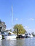 Anchored sailing ship and motorboats Royalty Free Stock Image