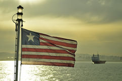 Anchored ship with liberian flag Stock Photography