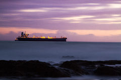 Anchored ship and purple sunset clouds Stock Photography