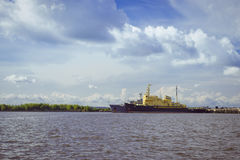 Anchored ships in Kronstadt. KRONSTADT, RUSSIA - AUGUST 23, 2014: Panoramic view from the promenade to the pier with an anchored ships in Kronstadt, Russia Royalty Free Stock Photo