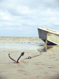 Anchored on the shore with boat Royalty Free Stock Image