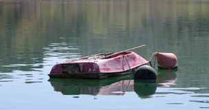 Anchored small boat. At peacefull waters of the Krka river in Skradin Croatia stock video