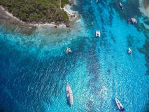 Anchored in Tobago Cays. Boats anchored in the beautiful, turquoise waters of Tobago Cays, St. Vincent and the Grenadines Stock Images