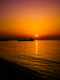 Anchored Transport Ship In The Sunset Royalty Free Stock Images