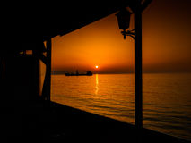 Anchored Transport Ship In The Sunset Stock Photography