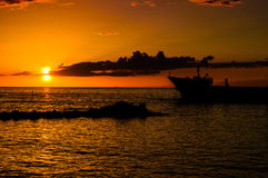Anchored Transport Ship In The Sunset Royalty Free Stock Photography