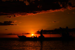 Anchored Transport Ship In The Sunset Royalty Free Stock Photo