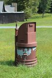 Anchored trash can in a park with a bear proof top Royalty Free Stock Images