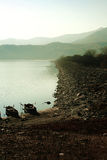 Anchored. Two fishing boats anchored at the shore in Kerkini lake.Foggy weather Royalty Free Stock Images