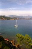 Anchored Yacht At Beautiful Coast Stock Photo