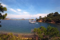 Anchored yacht in beautiful natural bay Royalty Free Stock Images