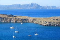 Anchored yachts and boats in blue sea bay stock photo
