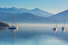 Anchored yachts at misty morning Royalty Free Stock Image