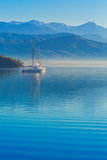 Anchored yachts at misty morning Stock Image