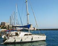 Anchored yachts. Side view of anchored passenger ships at sea port Stock Photo