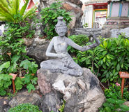 Anchorite. Stone statue at Wat Pho Stock Photo
