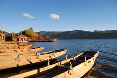 Anchors wooden boat. In the setting sun, a row of wooden boat calmly anchors in the harbor.here is the Chinese Sichuan is beautiful, original ecology Lugulake Stock Image