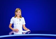 Anchorwoman at empty TV studio. A television anchorwoman at an empty blue studio, copy space Stock Photos